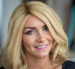 Female client with blonde mid length Enhancer system