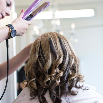 Olivias stylist makes finishing touches