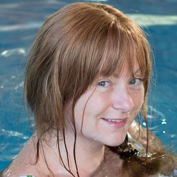 Smiling Client With Trichotillomania wears Enhancer System while swimming and no longer worries about getting hair wet