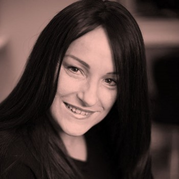 Client, Jo, Smiling with long dark hair again